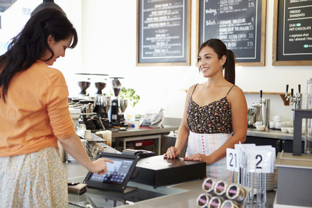 small business: Female Owner Of Coffee Shop