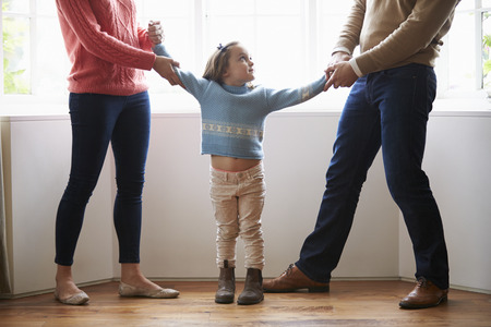 people fighting: Two Parents Fighting Over Child In Divorce Concept Stock Photo