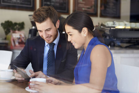 coffee meeting: Businessman And Businesswoman Meeting In Coffee Shop