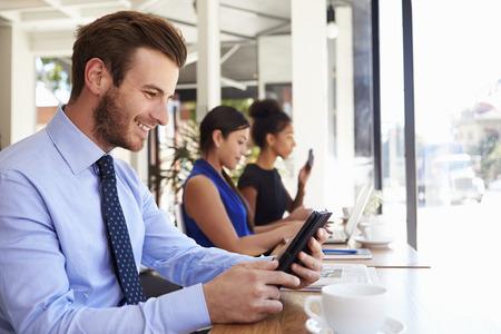 shop window: Businessman Using Digital Tablet In Coffee Shop