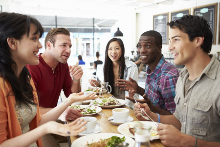 Group Of Friends Meeting For Lunch In Coffee Shop photo