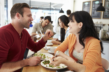 Couple Meeting For Lunch In Busy Caf� photo