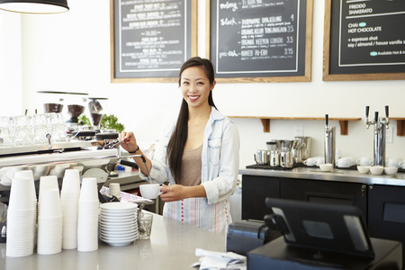 retail business: Female Owner Of Coffee Shop