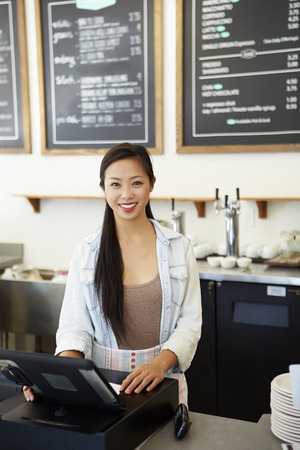 retail business: Male And Female Staff In Coffee Shop