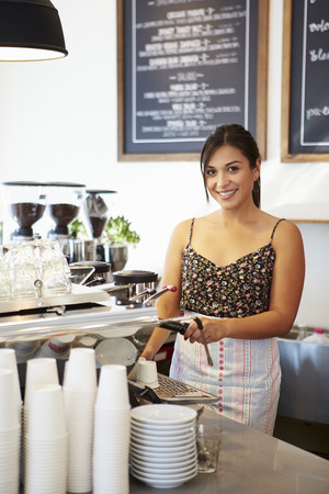 Female Staff In Coffee Shop photo