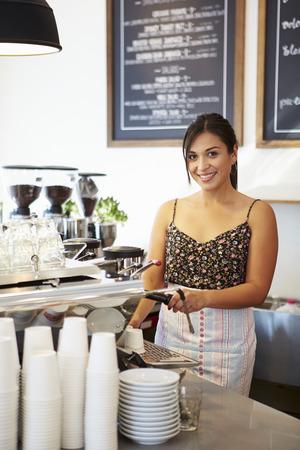 Female Staff In Coffee Shop photo