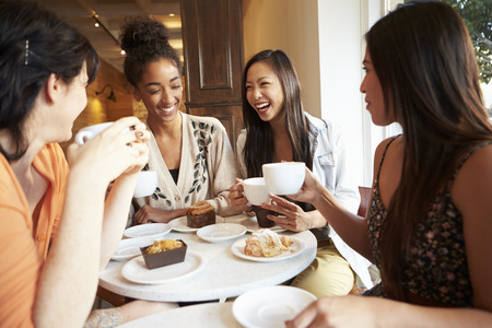 Group Of Male Friends Meeting In Café Restaurant photo
