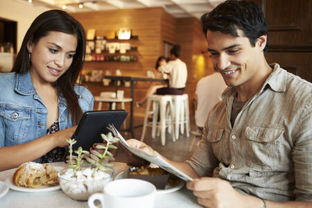 pastry shop: Couple Meeting In Busy Caf� Restaurant Stock Photo