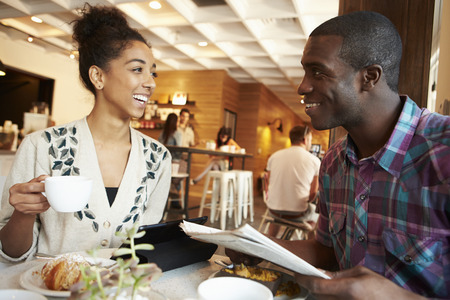 Couple Meeting In Busy Café Restaurant photo