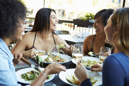 Group Of Female Friends Enjoying Meal At Outdoor Restaurant Stock Photo - 31021326
