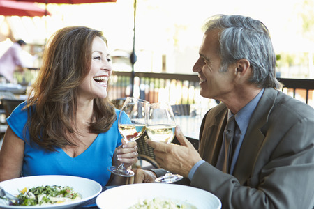 Mature Couple Enjoying Meal At Outdoor Restaurant photo