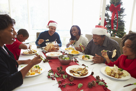 christmas turkey: Multi Generation Family Enjoying Christmas Meal At Home