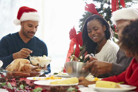 festive: Multi Generation Family Enjoying Christmas Meal At Home