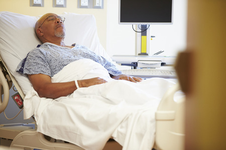 recovery bed: Senior Male Patient Resting In Hospital Bed