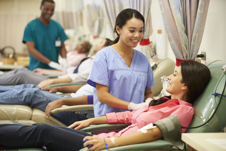 donation: Blood Donors Making Donation In Hospital