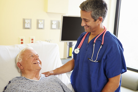 Male Doctor Talking With Senior Male Patient