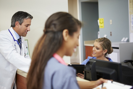 nurses station: Medical Staff Meeting At Nurses Station Stock Photo
