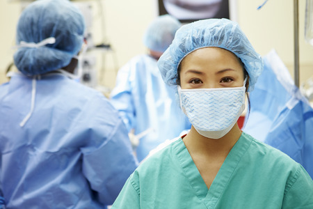 Portrait Of Nurse Working In Operating Theatre photo