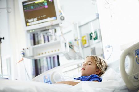 Young Girl Sleeping In Intensive Care Unit Foto de archivo