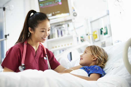 intensive care unit: Young Girl Talking To Female Nurse In Intensive Care Unit