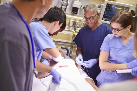 emergency room: Medical Team Working On Patient In Emergency Room