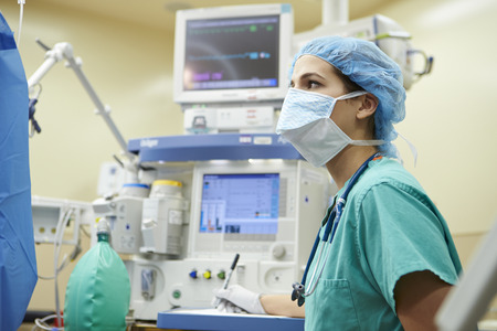 Anesthetist Working In Operating Theatre