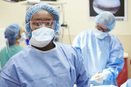Portrait Of Surgeon Working In Operating Theatre photo