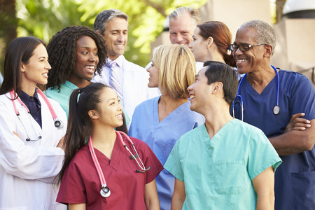 Medical Team Having Discussion Outdoors Stock Photo