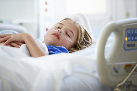 intensive care unit: Young Girl Sleeping In Intensive Care Unit Stock Photo