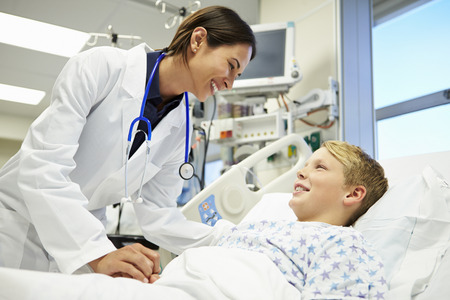 Boy Talking To Female Doctor In Emergency Room photo