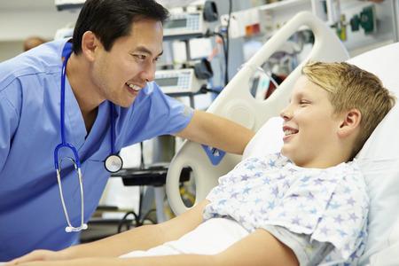 a nurse: Boy Talking To Male Nurse In Emergency Room Stock Photo