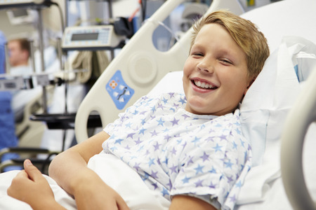 Young Male Patient In Hospital Bed Foto de archivo