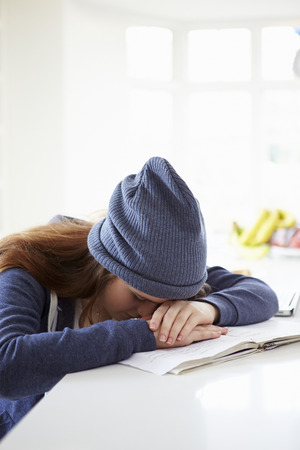 struggling: Depressed Girl Studying At Home Stock Photo
