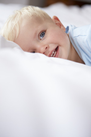 1 year old: Young Baby Boy Lying In Bed