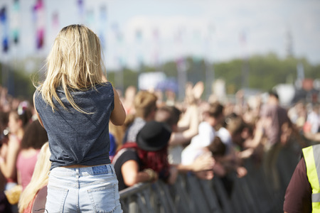 music festival: Young Woman At Outdoor Music Festival