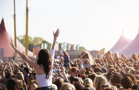 concert crowd: Crowds Enjoying Themselves At Outdoor Music Festival Stock Photo