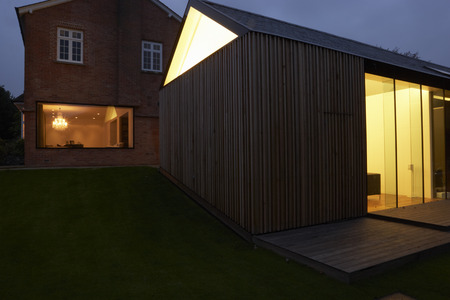 Exterior Of Modern House With Extension At Night photo