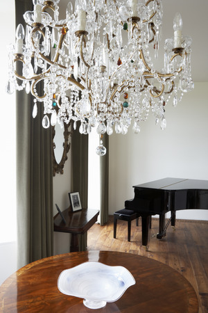 crystal chandelier: Room In Modern House With Chandelier And Grand Piano