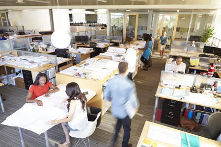 asian architect: Interior Of Busy Modern Open Plan Office Stock Photo