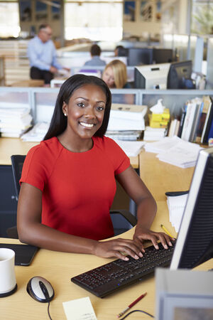 open plan: Woman Working At Computer In Modern Office Stock Photo