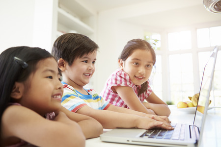 4 5 year old: Three Asian Children Using Laptop At Home
