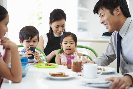 chinese meal: Asian Family Having Breakfast Before Husband Goes To Work