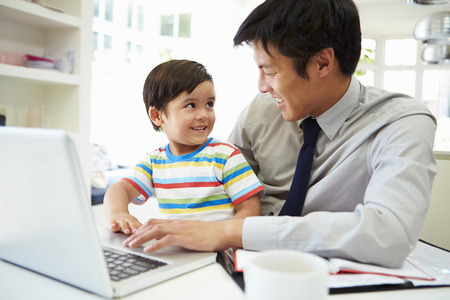 Busy Father Working From Home With Son Stock Photo - 31047131