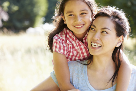 caucasian: Portrait Of Asian Mother And Daughter In Countryside