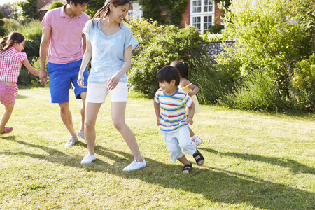 family exercise: Asian Family Playing In Summer Garden Together