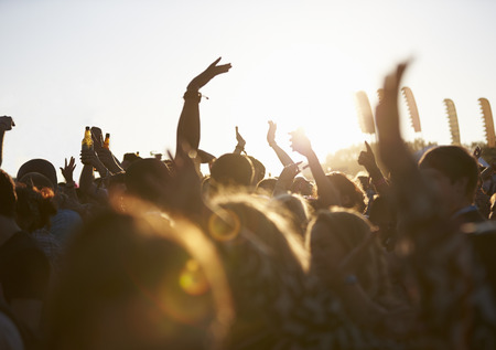 summer festival: Crowds Enjoying Themselves At Outdoor Music Festival Stock Photo