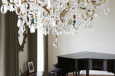 chandeliers: Room In Modern House With Chandelier And Grand Piano