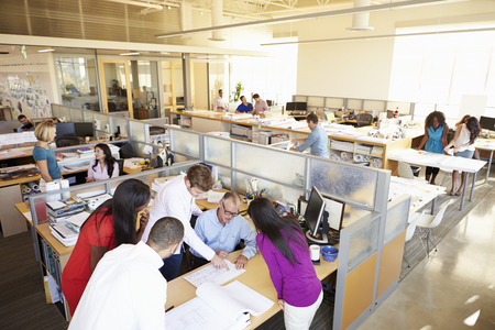 BUSY OFFICE: Interior Of Busy Modern Open Plan Office Stock Photo