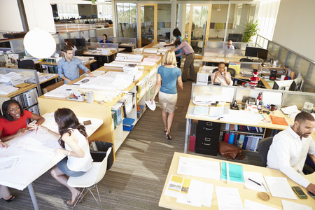 Interior Of Busy Modern Open Plan Office Standard-Bild