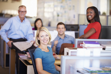 casual caucasian: Portrait Of Businesspeople In Modern Open Plan Office Stock Photo